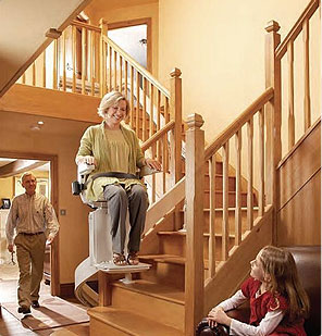 Lady on straight stairlift South Wales and the South West