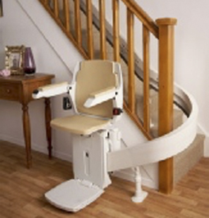 Lady on curved stairlift in South Wales