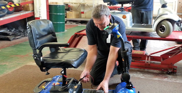 Repairing a mobility scooter in Bargoed